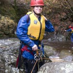 "Lucy emerges from the ""Elephant's Bum"" in the Afon Ddu Gorge"